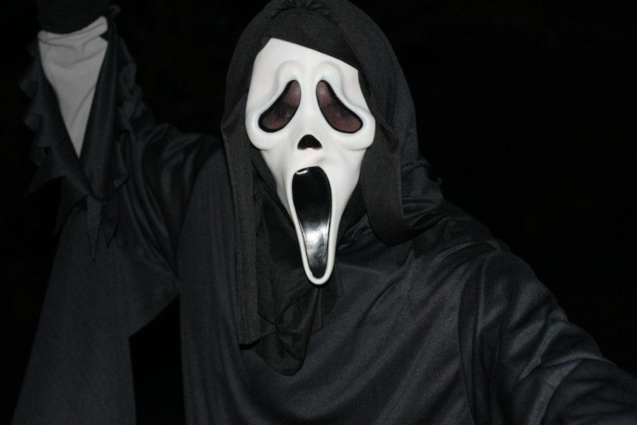 black hooded figure